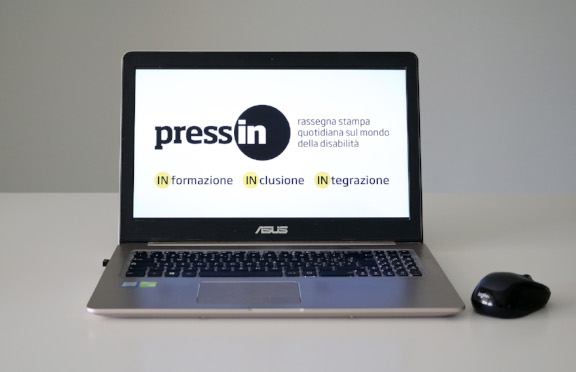 Logo Press-IN su schermo notebook